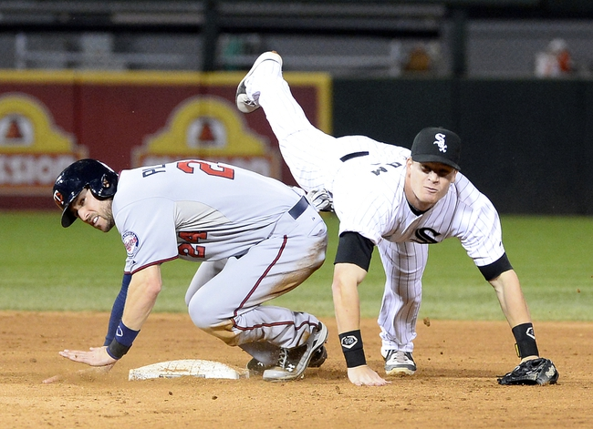 Sep 17, 2013; Chicago, IL, USA; Chicago White Sox second baseman Gordon Beckham (15) attempts to make a double play against Minnesota Twins third baseman Trevor Plouffe (24) during the sev