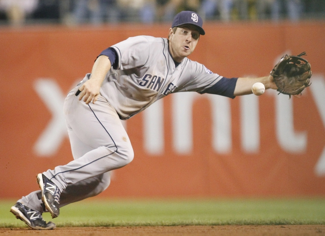 Sep 17, 2013; Pittsburgh, PA, USA; San Diego Padres second baseman Jedd Gyorko (9) fields a ground ball against the Pittsburgh Pirates during the ninth inning at PNC Park. The Padres won 5-2. Mandatory Credit: Charles LeClaire-USA TODAY Sports