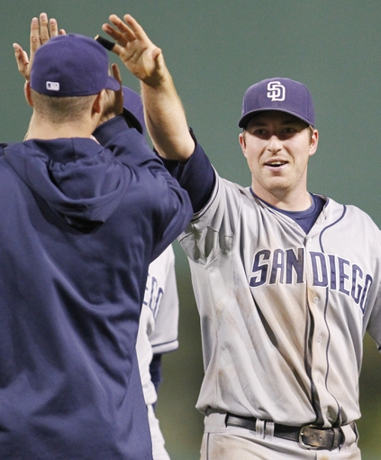 Sep 17, 2013; Pittsburgh, PA, USA; San Diego Padres second baseman Jedd Gyorko (9) high-fives teammates after defeating the Pittsburgh Pirates at PNC Park. The Padres won 5-2. Mandatory Credit: Charles LeClaire-USA TODAY Sports