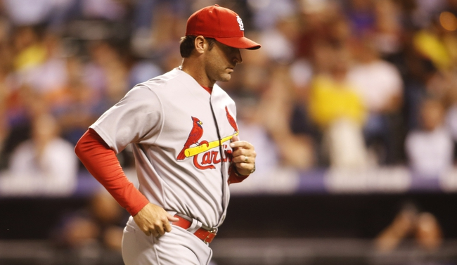 Sep 17, 2013; Denver, CO, USA; St. Louis Cardinals manager Mike Matheny (22) returns to the dugout during the fifth inning against the Colorado Rockies at Coors Field. Mandatory Credit: Chris Humphreys-USA TODAY Sports