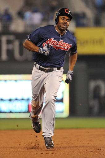 Sep 17, 2013; Kansas City, MO, USA; Cleveland Indians center fielder Michael Bourn (24) runs the bases after hitting a home run in the ninth inning against the Kansas City Royals at Kauffman Stadium. The Indians won 5-3. Mandatory Credit: John Rieger-USA TODAY Sports