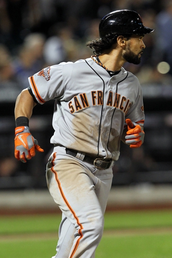 Sep 17, 2013; New York, NY, USA; San Francisco Giants center fielder Angel Pagan (16) hits a solo home run against the New York Mets during the seventh inning of a game at Citi Field. Mandatory Credit: Brad Penner-USA TODAY Sports