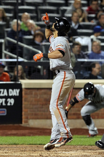 Sep 17, 2013; New York, NY, USA; San Francisco Giants center fielder Angel Pagan (16) celebrates after hitting a solo home run against the New York Mets during the seventh inning of a game at Citi Field. Mandatory Credit: Brad Penner-USA TODAY Sports