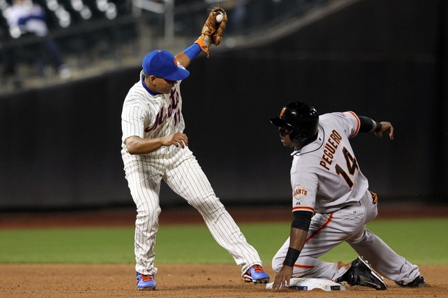 Sep 17, 2013; New York, NY, USA; San Francisco Giants pinch runner Francisco Peguero (14) steals second safely ahead of a tag by New York Mets shortstop Ruben Tejada (11) during the eighth inning of a game at Citi Field. Mandatory Credit: Brad Penner-USA TODAY Sports