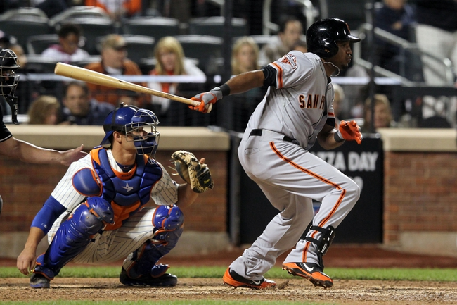 Sep 17, 2013; New York, NY, USA; San Francisco Giants second baseman Tony Abreu (10) hits an RBI double against the New York Mets during the eighth inning of a game at Citi Field. Mandatory Credit: Brad Penner-USA TODAY Sports