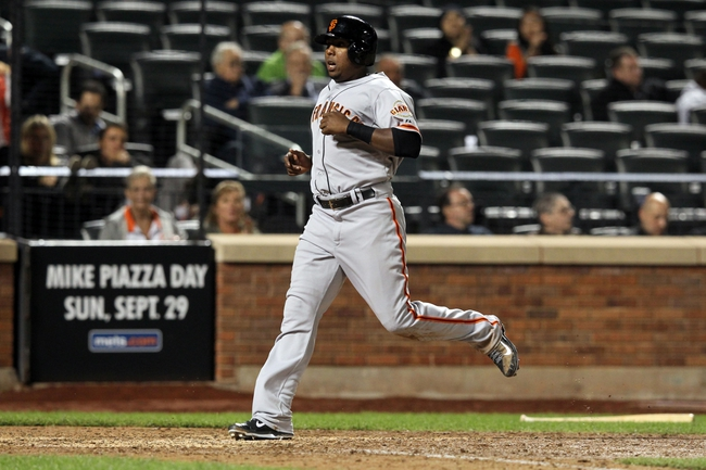 Sep 17, 2013; New York, NY, USA; San Francisco Giants pinch runner Francisco Peguero (14) scores a run against the New York Mets during the eighth inning of a game at Citi Field. Mandatory Credit: Brad Penner-USA TODAY Sports