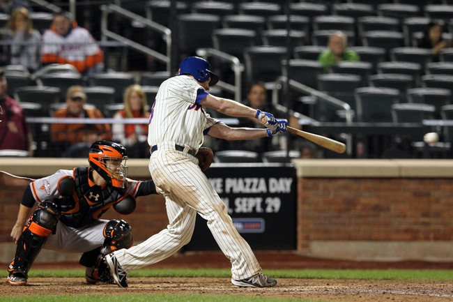 Sep 17, 2013; New York, NY, USA; New York Mets second baseman Daniel Murphy (28) hits an RBI single against the San Francisco Giants during the ninth inning of a game at Citi Field. Mandatory Credit: Brad Penner-USA TODAY Sports