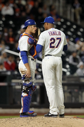 Sep 17, 2013; New York, NY, USA; New York Mets catcher Anthony Recker (20) talks with New York Mets relief pitcher Jeurys Familia (27) during the ninth inning of a game against the San Francisco Giants at Citi Field. Mandatory Credit: Brad Penner-USA TODAY Sports