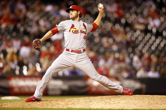 Sep 17, 2013; Denver, CO, USA; St. Louis Cardinals pitcher Kevin Siegrist (46) delivers a pitch during the ninth inning against the Colorado Rockies at Coors Field. The Cardinals won 11-4.  Mandatory Credit: Chris Humphreys-USA TODAY Sports