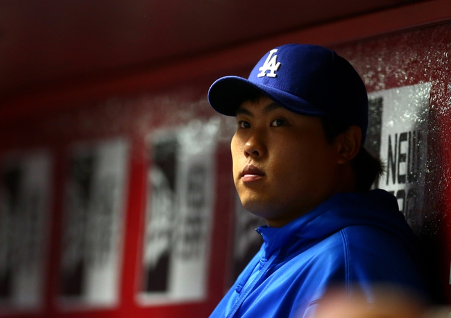 Sept. 17, 2013; Phoenix, AZ, USA: Los Angeles Dodgers pitcher Hyun-Jin Ryu in the dugout during the ninth inning against the Arizona Diamondbacks at Chase Field. Mandatory Credit: Mark J. Rebilas-USA TODAY Sports