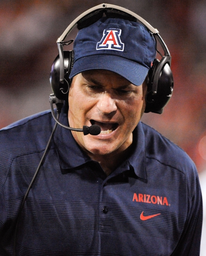 Sep 14, 2013; Tucson, AZ, USA; Arizona Wildcats head coach Rich Rodriguez instructs his players during the fourth quarter against the Texas-San Antonio Roadrunners at Arizona Stadium. The Wildcats defeated the Roadrunners 38-13. Mandatory Credit: Casey Sapio-USA TODAY Sports