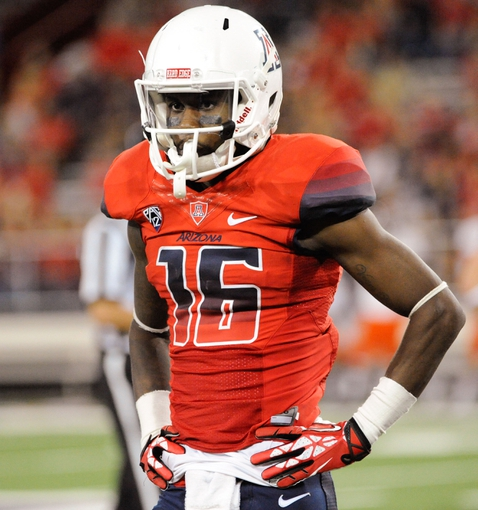 Sep 14, 2013; Tucson, AZ, USA; Arizona Wildcats receiver Garic Wharton (16) in between plays during the fourth quarter against the Texas-San Antonio Roadrunners at Arizona Stadium. The Wildcats defeated the Roadrunners 38-13. Mandatory Credit: Casey Sapio-USA TODAY Sports