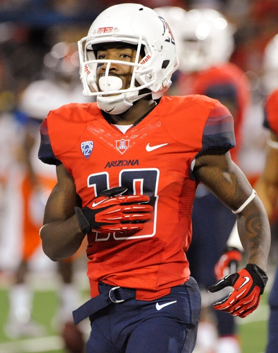 Sep 14, 2013; Tucson, AZ, USA; Arizona Wildcats receiver Samajie Grant (10) in between plays during the fourth quarter against the Texas-San Antonio Roadrunners at Arizona Stadium. The Wildcats defeated the Roadrunners 38-13. Mandatory Credit: Casey Sapio-USA TODAY Sports