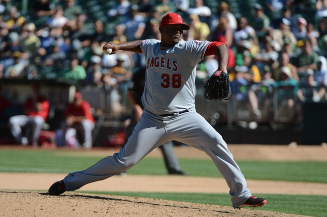 September 18, 2013; Oakland, CA, USA; Los Angeles Angels relief pitcher J.C. Gutierrez (38) delivers a pitch against the Oakland Athletics during the 10th inning at O.co Coliseum. The Angels defeated the Athletics 5-4 in 11 innings. Mandatory Credit: Kyle Terada-USA TODAY Sports