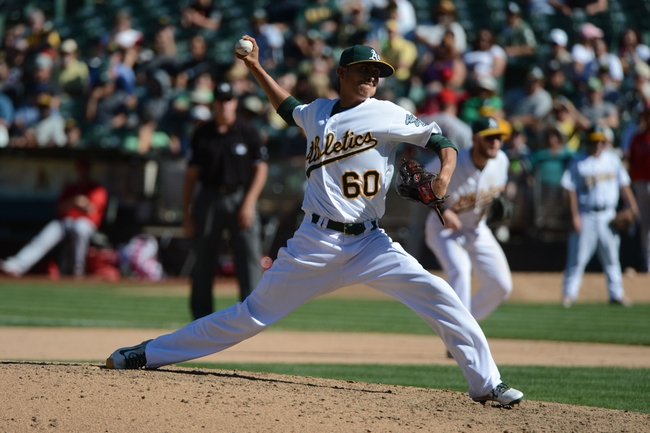September 18, 2013; Oakland, CA, USA; Oakland Athletics relief pitcher Jesse Chavez (60) delivers a pitch against the Los Angeles Angels during the 11th inning at O.co Coliseum. The Angels defeated the Athletics 5-4 in 11 innings. Mandatory Credit: Kyle Terada-USA TODAY Sports