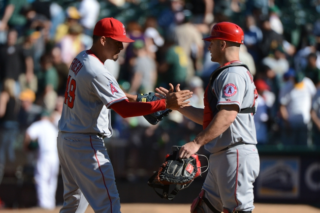 September 18, 2013; Oakland, CA, USA; Los Angeles Angels relief pitcher Ernesto Frieri (49) celebrates with catcher Chris Iannetta (17, right) after the game against the Oakland Athletics at O.co Coliseum. The Angels defeated the Athletics 5-4 in 11 innings. Mandatory Credit: Kyle Terada-USA TODAY Sports