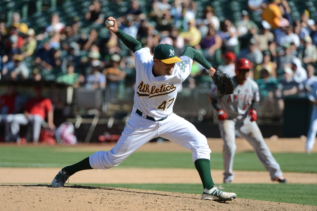 September 18, 2013; Oakland, CA, USA; Oakland Athletics relief pitcher Pat Neshek (47) delivers a pitch against the Los Angeles Angels during the 11th inning at O.co Coliseum. The Angels defeated the Athletics 5-4 in 11 innings. Mandatory Credit: Kyle Terada-USA TODAY Sports