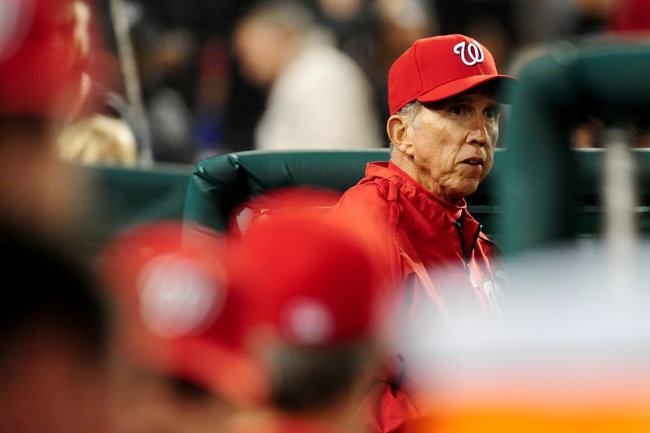 Sep 18, 2013; Washington, DC, USA; Washington Nationals manager Davey Johnson (right) looks on during the game against the Atlanta Braves at Nationals Park. Mandatory Credit: Evan Habeeb-USA TODAY Sports