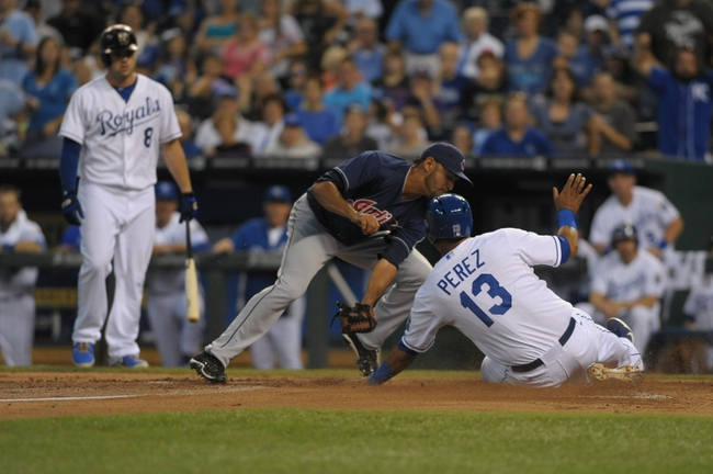 Sep 18, 2013; Kansas City, MO, USA; Cleveland Indians starting pitcher Danny Salazar (31) can't make the tag as Kansas City Royals catcher Salvador Perez (13) steals home on a wild pitch in the first inning at Kauffman Stadium. Mandatory Credit: Denny Medley-USA TODAY Sports
