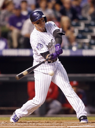 Sep 18, 2013; Denver, CO, USA; Colorado Rockies shortstop Troy Tulowitzki (2) hits an RBI single during the first inning against the St. Louis Cardinals at Coors Field. Mandatory Credit: Chris Humphreys-USA TODAY Sports
