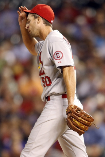 Sep 18, 2013; Denver, CO, USA; St. Louis Cardinals pitcher Adam Wainwright (50) reacts during the second inning against the Colorado Rockies at Coors Field.  Mandatory Credit: Chris Humphreys-USA TODAY Sports