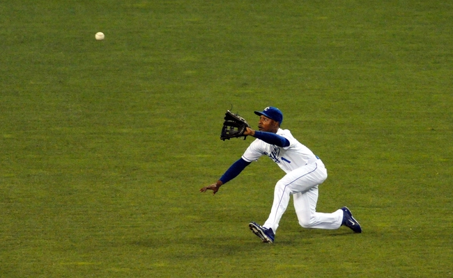 Sep 18, 2013; Kansas City, MO, USA; Kansas City Royals center fielder Jarrod Dyson (1) fields a fly ball to right field in the fifth inning of the game against the Cleveland Indians at Kauffman Stadium. Mandatory Credit: Denny Medley-USA TODAY Sports