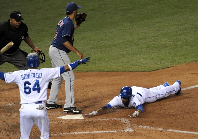 Sep 18, 2013; Kansas City, MO, USA; Kansas City Royals shortstop Alcides Escobar (2) touches home plate in the fifth inning of the game against the Cleveland Indians at Kauffman Stadium. Mandatory Credit: Denny Medley-USA TODAY Sports