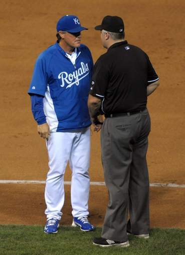 Sep 18, 2013; Kansas City, MO, USA; Kansas City Royals manager Ned Yost (3) argues a call with first base umpire Bill Welke (52) in the fifth inning of the game against the Cleveland Indians at Kauffman Stadium. Mandatory Credit: Denny Medley-USA TODAY Sports
