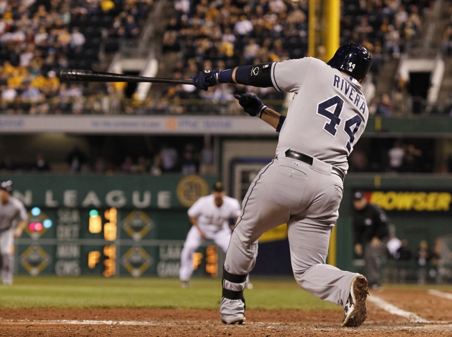 Sep 18, 2013; Pittsburgh, PA, USA; San Diego Padres catcher Rene Rivera (44) hits a game winning RBI single to right against the Pittsburgh Pirates during the ninth inning at PNC Park. The San Diego Padres won 3-2. Mandatory Credit: Charles LeClaire-USA TODAY Sports