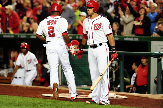 Sep 18, 2013; Washington, DC, USA; Washington Nationals outfielder Denard Span (2) high fives shortstop Ian Desmond (20) after scoring a run in the fifth inning against the Atlanta Braves at Nationals Park. Mandatory Credit: Evan Habeeb-USA TODAY Sports
