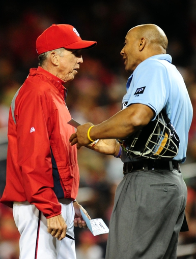 Sep 18, 2013; Washington, DC, USA; Washington Nationals manager Davey Johnson (left) talks to home plate umpire CB Buckner (right) during the game against the Atlanta Braves at Nationals Park. Mandatory Credit: Evan Habeeb-USA TODAY Sports