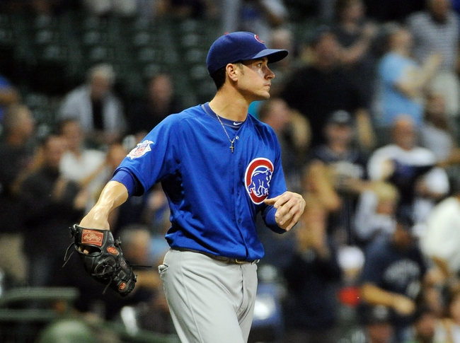 Sep 18, 2013; Milwaukee, WI, USA;   Chicago Cubs pitcher Chris Rusin reacts after giving up a grand slam home run to Milwaukee Brewers first baseman Sean Halton (not pictured) in the first inning at Miller Park. Mandatory Credit: Benny Sieu-USA TODAY Sports