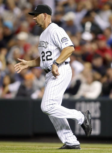 Sep 18, 2013; Denver, CO, USA; Colorado Rockies manager Walt Weiss (22) runs out onto the field during the fifth inning against the St. Louis Cardinals at Coors Field. Mandatory Credit: Chris Humphreys-USA TODAY Sports