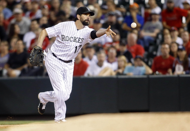 Sep 18, 2013; Denver, CO, USA; Colorado Rockies first baseman Todd Helton (17) fields a ground ball during the sixth inning against the St. Louis Cardinals at Coors Field. Mandatory Credit: Chris Humphreys-USA TODAY Sports