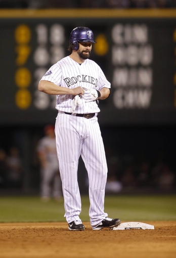 Sep 18, 2013; Denver, CO, USA; Colorado Rockies first baseman Todd Helton (17) on second base after hitting a double during the sixth inning against the St. Louis Cardinals at Coors Field. Mandatory Credit: Chris Humphreys-USA TODAY Sports