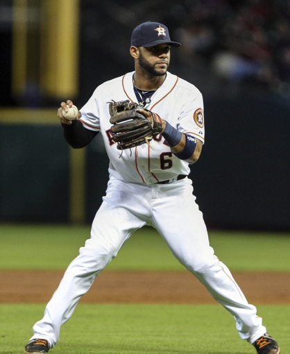 Sep 18, 2013; Houston, TX, USA; Houston Astros shortstop Jonathan Villar (6) fields a ground ball during the sixth inning against the Cincinnati Reds at Minute Maid Park. Mandatory Credit: Troy Taormina-USA TODAY Sports