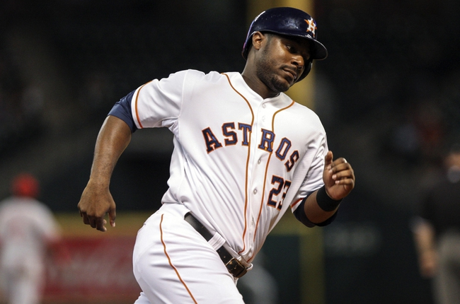Sep 18, 2013; Houston, TX, USA; Houston Astros left fielder Chris Carter (23) rounds third base and scores a run during the sixth inning against the Cincinnati Reds at Minute Maid Park. Mandatory Credit: Troy Taormina-USA TODAY Sports
