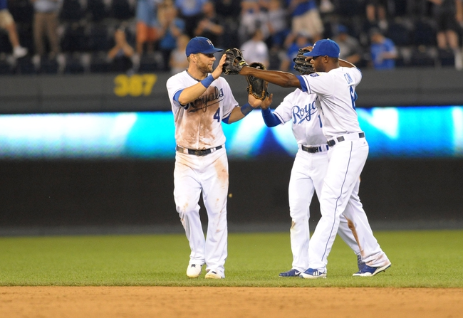Sep 18, 2013; Kansas City, MO, USA; Kansas City Royals outfielders Alex Gordon (4) , Jarrod Dyson (1) and  Lorenzo Cain (6) celebrate in the outfield after the game against the Cleveland Indians at Kauffman Stadium. The Royals won 7-2. Mandatory Credit: Denny Medley-USA TODAY Sports