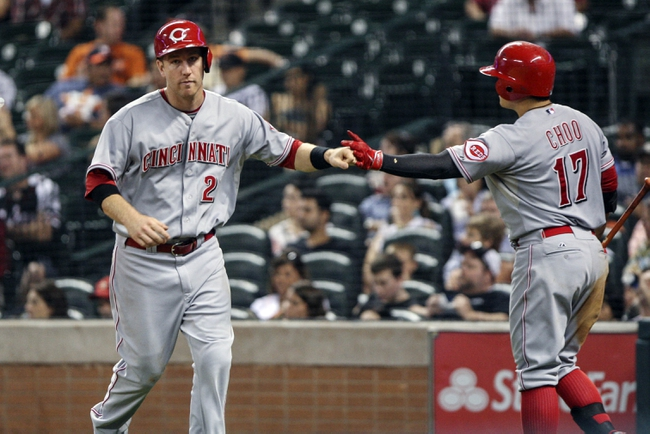 Sep 18, 2013; Houston, TX, USA; Cincinnati Reds third baseman Todd Frazier (21) is congratulated by center fielder Shin-Soo Choo (17) after scoring a run during the sixth inning against the Houston Astros at Minute Maid Park. Mandatory Credit: Troy Taormina-USA TODAY Sports