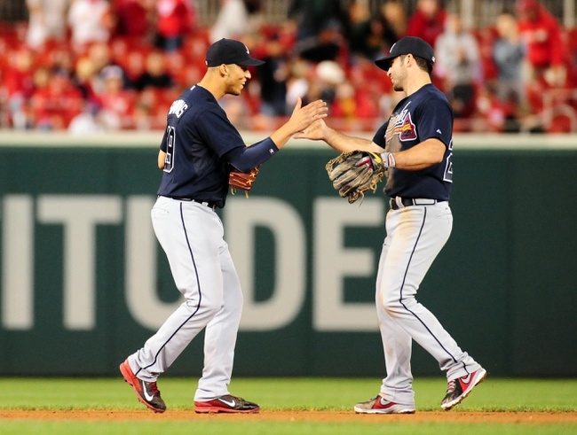 Sep 18, 2013; Washington, DC, USA; Atlanta Braves shortstop Andrelton Simmons (left) high fives second baseman Dan Uggla (right) after beating the Washington Nationals 5-2 at Nationals Park. Mandatory Credit: Evan Habeeb-USA TODAY Sports