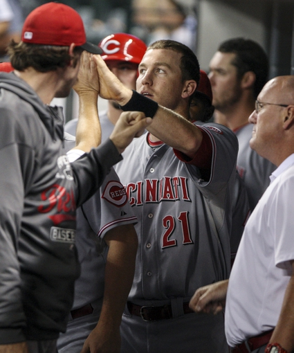 Sep 18, 2013; Houston, TX, USA; Cincinnati Reds third baseman Todd Frazier (21) is congratulated in the dugout after scoring a run during the sixth inning against the Houston Astros at Minute Maid Park. Mandatory Credit: Troy Taormina-USA TODAY Sports