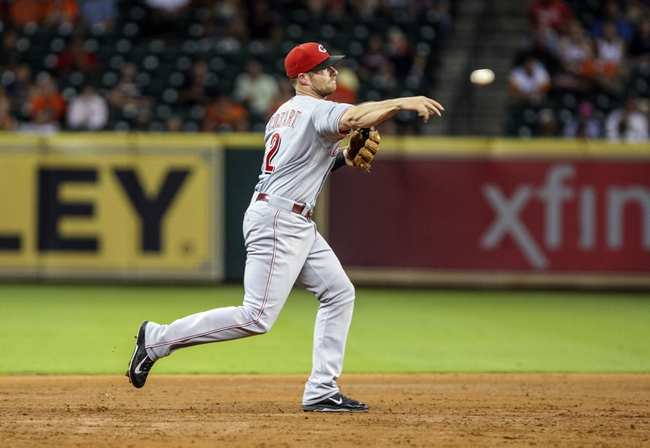 Sep 18, 2013; Houston, TX, USA; Cincinnati Reds shortstop Zack Cozart (2) throws to first base during the sixth inning against the Houston Astros at Minute Maid Park. Mandatory Credit: Troy Taormina-USA TODAY Sports