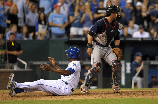 Sep 18, 2013; Kansas City, MO, USA; Cleveland Indians catcher Yan Gomes (10) cannot make the tag as Kansas City Royals center fielder Lorenzo Cain (6) scores in the eighth  inning at Kauffman Stadium. The Royals won 7-2. Mandatory Credit: Denny Medley-USA TODAY Sports