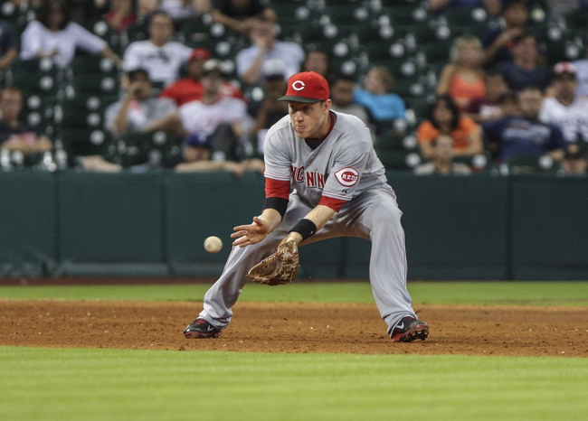 Sep 18, 2013; Houston, TX, USA; Cincinnati Reds third baseman Todd Frazier (21) fields a ground ball during the eighth inning against the Houston Astros at Minute Maid Park. Mandatory Credit: Troy Taormina-USA TODAY Sports