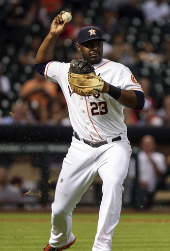 Sep 18, 2013; Houston, TX, USA; Houston Astros first baseman Chris Carter (23) throws to first base during the ninth inning against the Cincinnati Reds at Minute Maid Park. Mandatory Credit: Troy Taormina-USA TODAY Sports