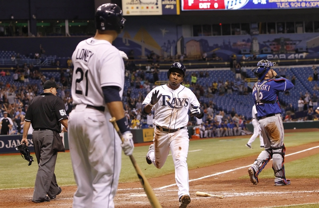 Sep 18, 2013; St. Petersburg, FL, USA; Tampa Bay Rays outfielder Freddy Guzman (43) scores a run in the eleventh inning against the Texas Rangers at Tropicana Field. Mandatory Credit: Kim Klement-USA TODAY Sports