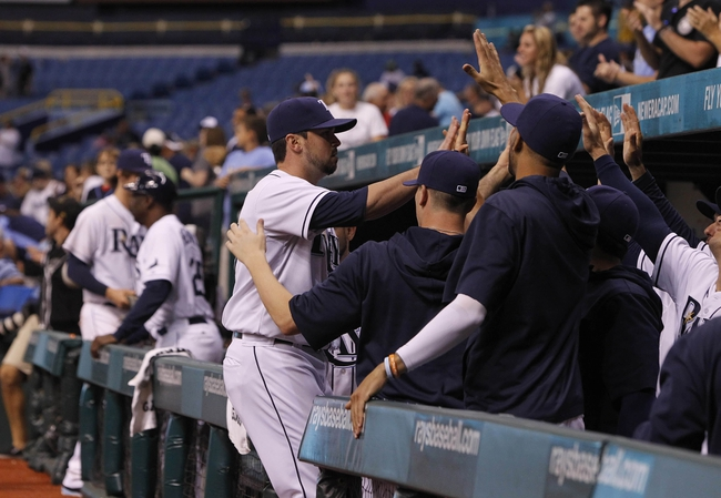 Sep 18, 2013; St. Petersburg, FL, USA; Tampa Bay Rays relief pitcher Brandon Gomes (47) is congratulated by teammates after pitching the twelfth inning against the Texas Rangers at Tropicana Field. Tampa Bay Rays defeated the Texas Rangers 4-3 in twelve innings. Mandatory Credit: Kim Klement-USA TODAY Sports