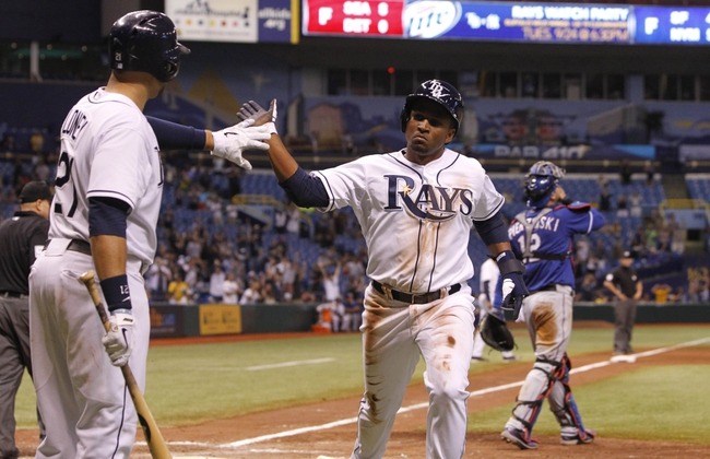 Sep 18, 2013; St. Petersburg, FL, USA; Tampa Bay Rays outfielder Freddy Guzman (43) is congratulated by first baseman James Loney (21) after scoring a run during the eleventh inning against the Texas Rangers  for at Tropicana Field. Mandatory Credit: Kim Klement-USA TODAY Sports