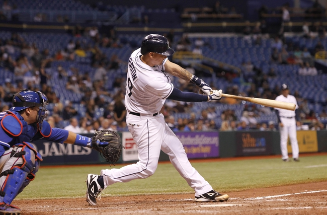 Sep 18, 2013; St. Petersburg, FL, USA; Tampa Bay Rays catcher Jose Lobaton (59) singles during the twelfth inning against the Texas Rangers at Tropicana Field. Tampa Bay Rays defeated the Texas Rangers 4-3 in twelve innings. Mandatory Credit: Kim Klement-USA TODAY Sports