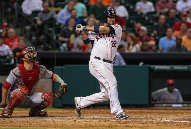 Sep 18, 2013; Houston, TX, USA; Houston Astros catcher Carlos Corporan (22) bats during the ninth inning against the Cincinnati Reds at Minute Maid Park. Mandatory Credit: Troy Taormina-USA TODAY Sports